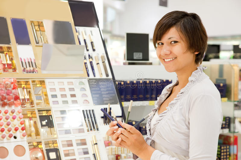 Young woman at cosmetics shop royalty free stock image