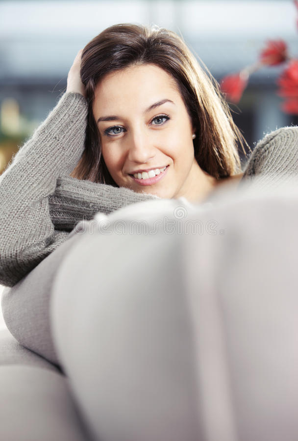 Young Woman On Couch Stock Photo