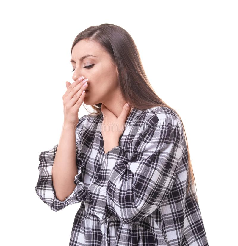 Young woman coughing. On white background stock photography