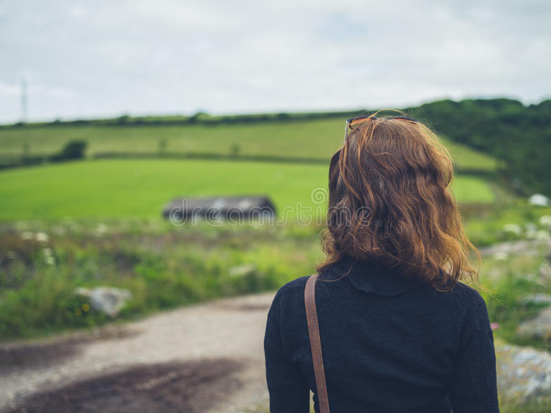 Young woman in the countryside. A young woman is walking in the countryside royalty free stock photo