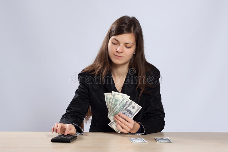 Young woman counts money royalty free stock photos