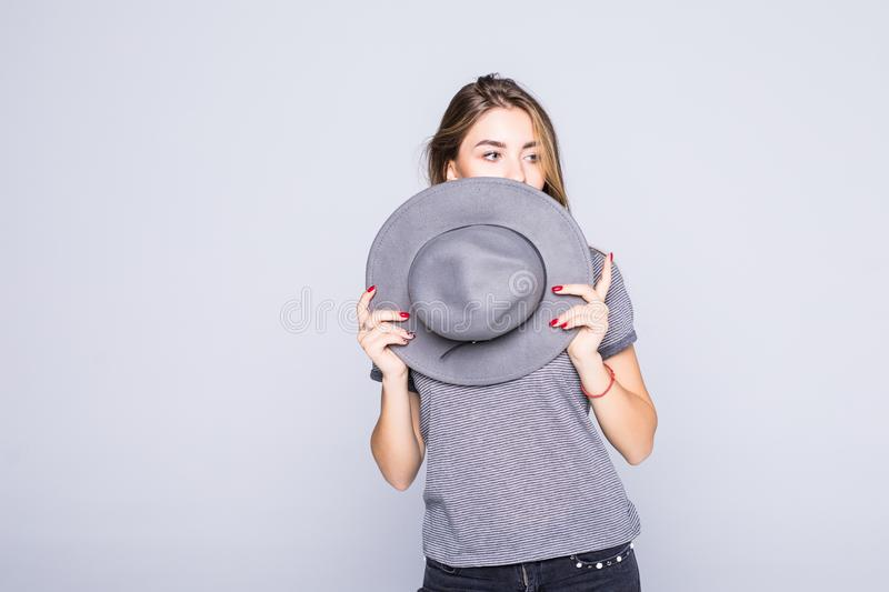 Young woman cover face with summer hat isolated on white background. Young woman cover face with hat isolated on white background stock photo