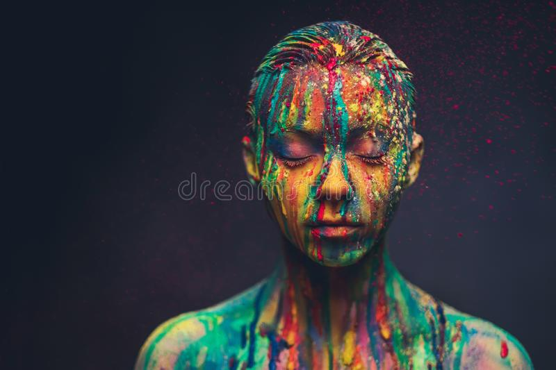 Young woman covered with a colourful paint stock photography