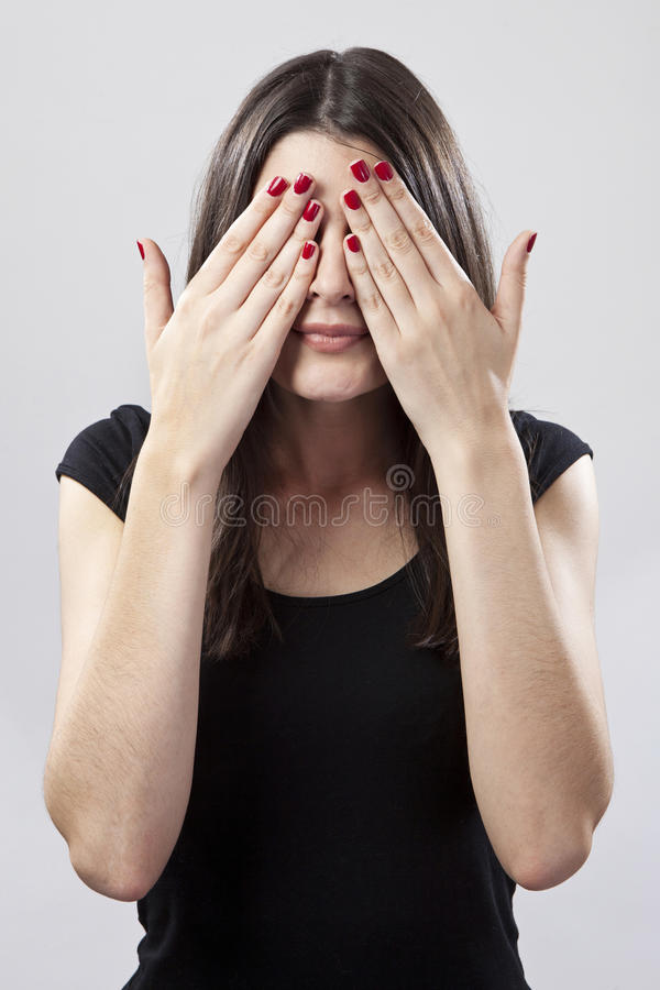 Young woman covering eyes. Young woman covering her eyes stock photos