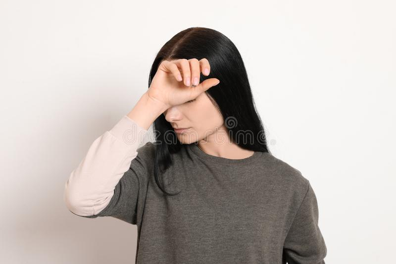 Young woman covering face against white. Background royalty free stock photos