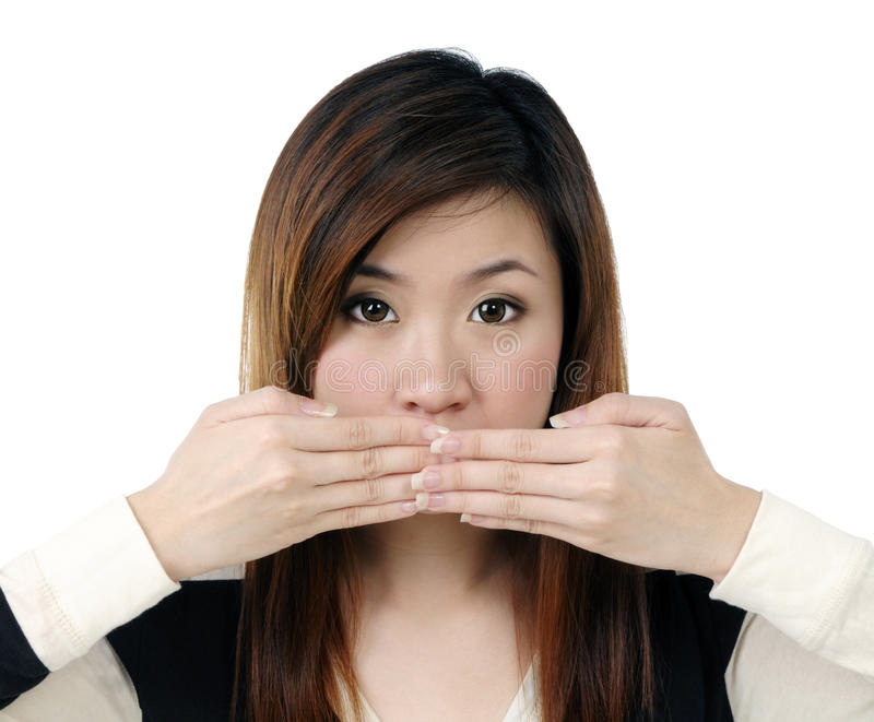Download Young Woman Covering Her Mouth With Both Hands Stock Photo - Image of hands, studio: 14180766