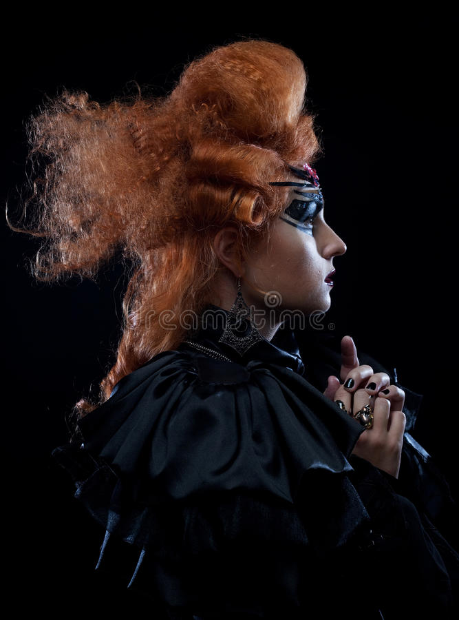 Young woman with creative hairstyle and make up stock photos