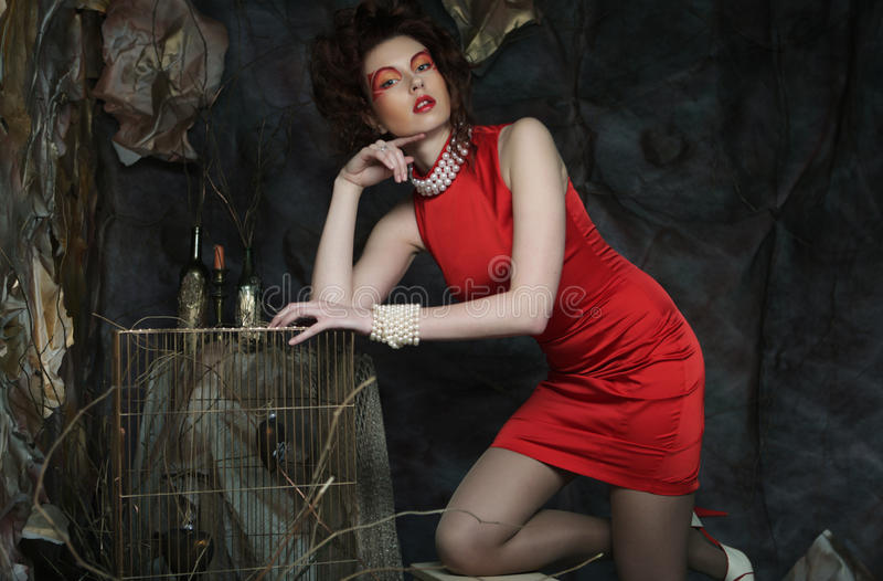 Young woman with creative visage wearing red dress royalty free stock image
