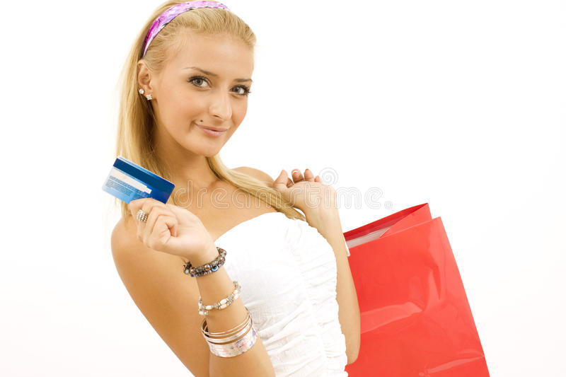 Young woman with credit card royalty free stock images