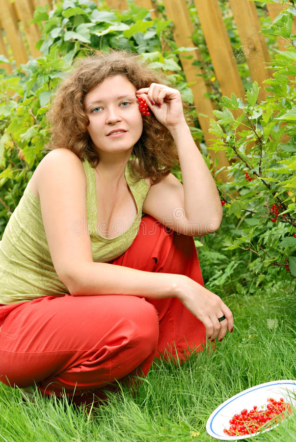 Young woman with crop of red currant stock image