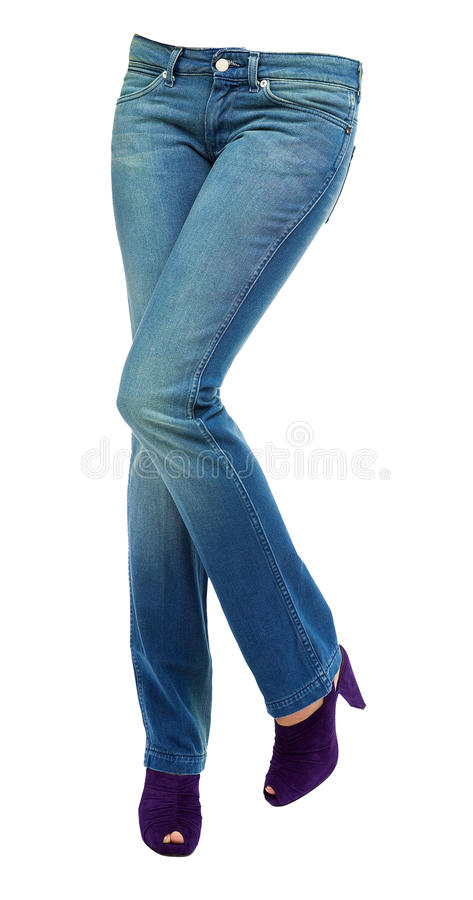 Young woman crossed legs with clear blue jeans and purple peep t royalty free stock image