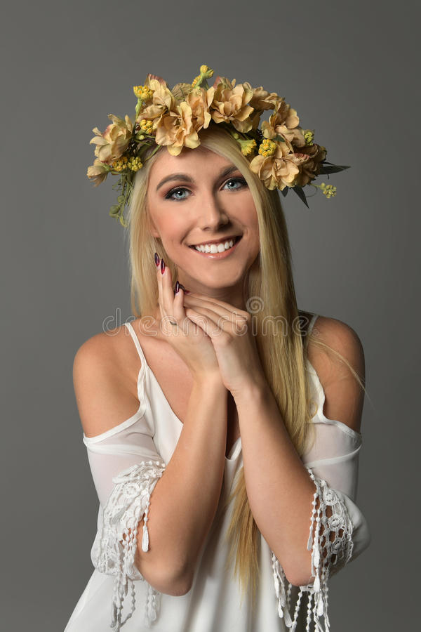 Young Woman With Crown of Flowers stock image