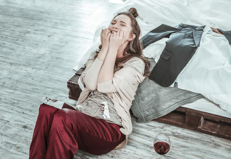 Young woman crying alone at her home stock photos