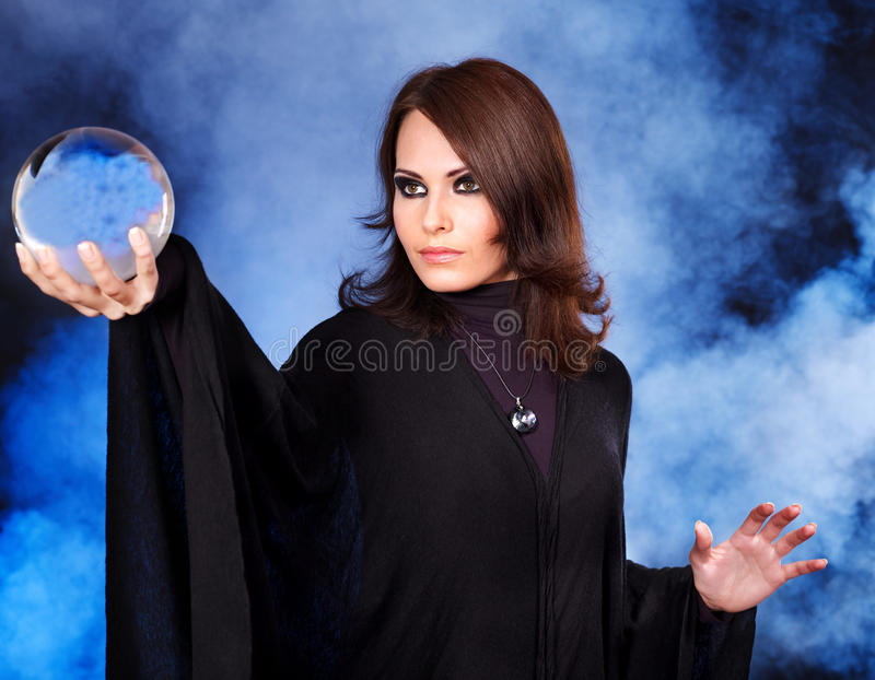 Young woman with crystal ball. royalty free stock images