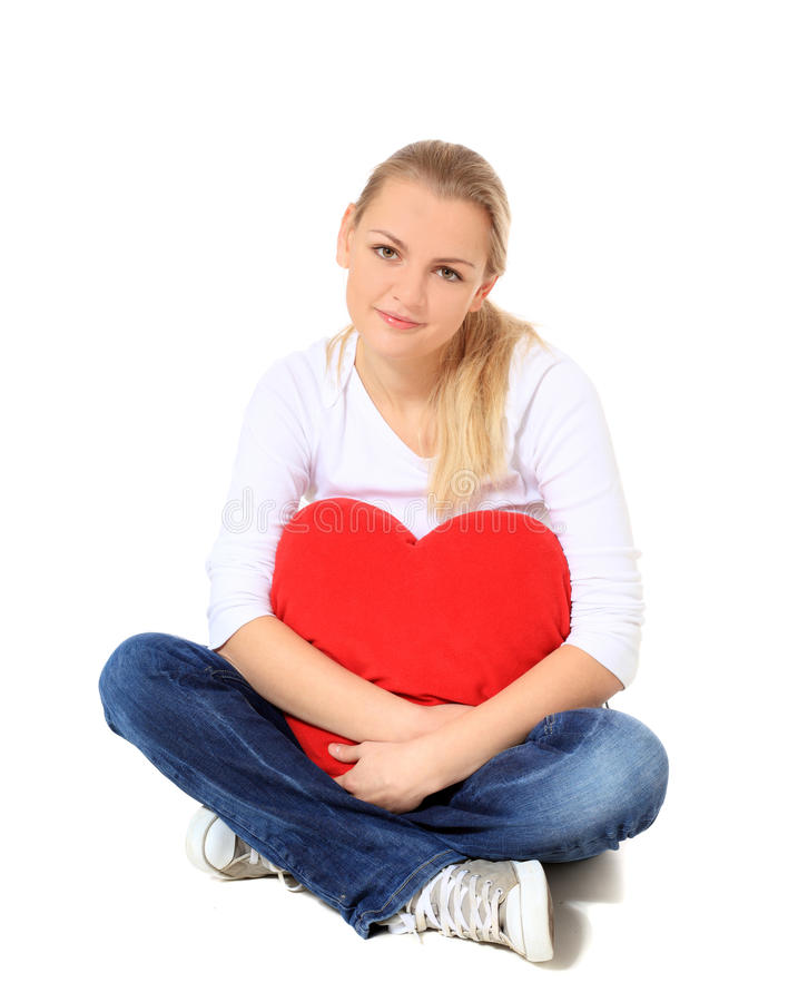 Young Woman Cuddling Heart Shaped Pillow Stock Photos