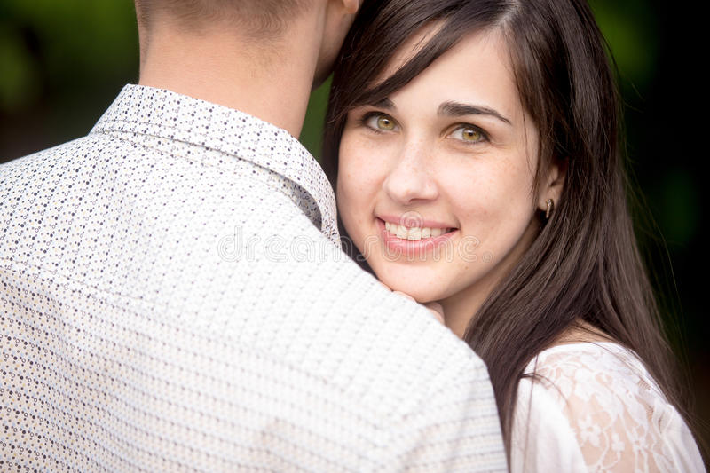 Young woman cuddling with her boyfriend stock photos