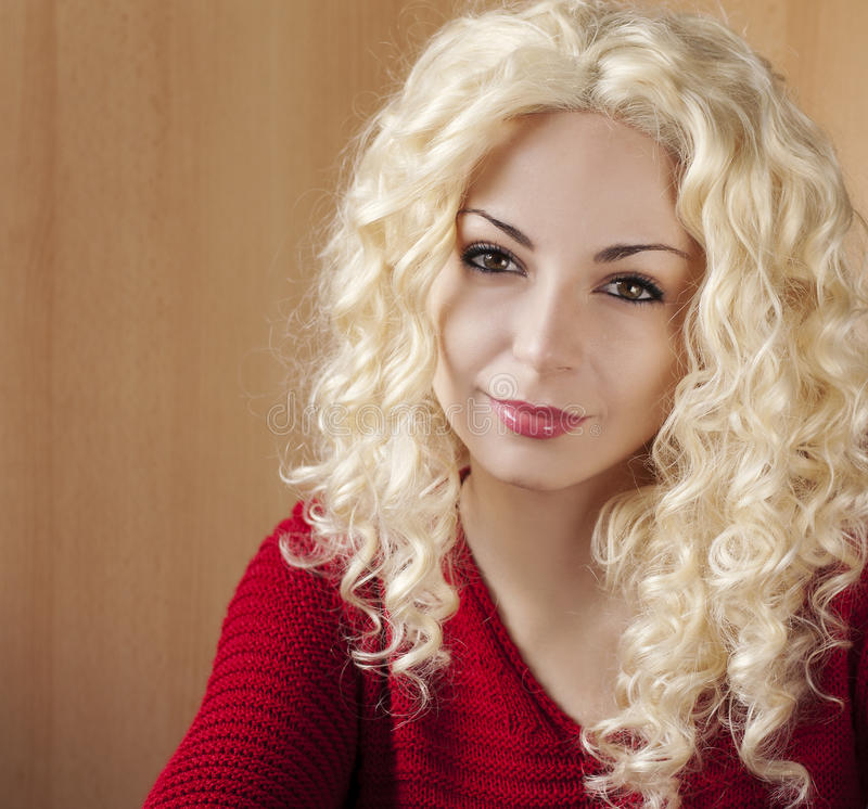 Young woman with curly blond hair. Beautiful young woman with curly blond hair royalty free stock photography