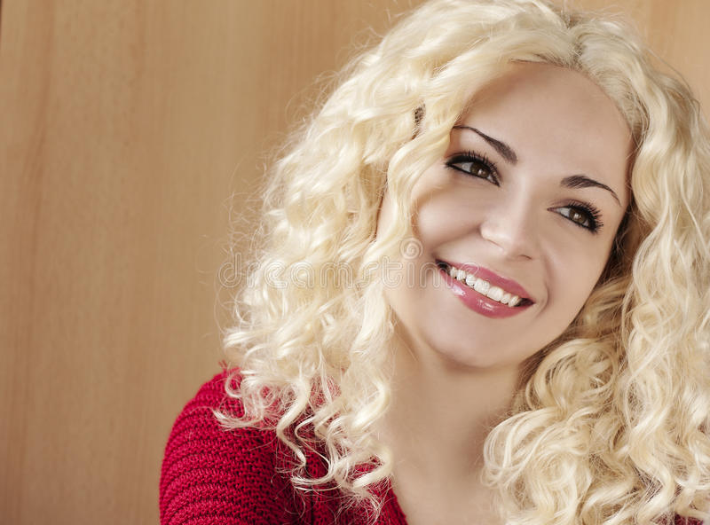 Young woman with curly blond hair. Beautiful young woman with curly blond hair stock photos