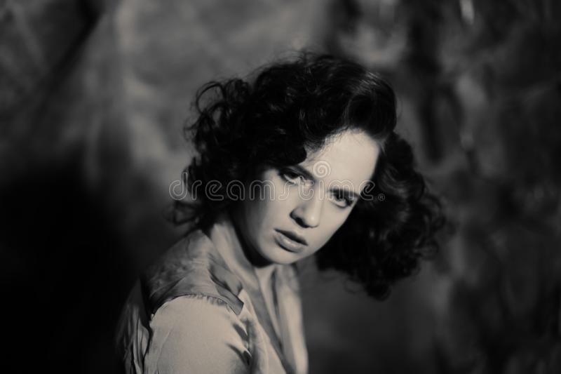 Young woman with curly hair. Portrait of beauty young woman with curly hair - black and white image stock photo