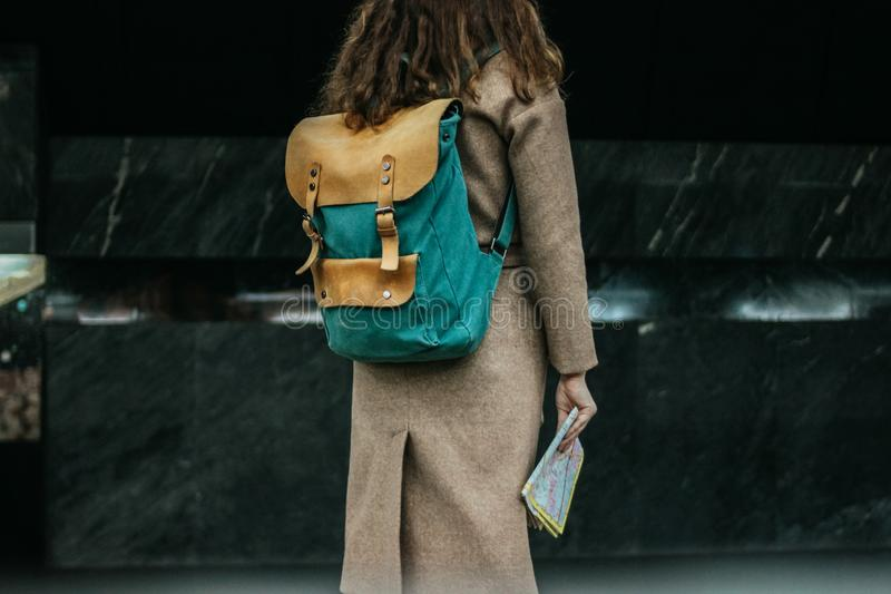Young woman curly red head girl traveller with backpack and map in subway station royalty free stock photos