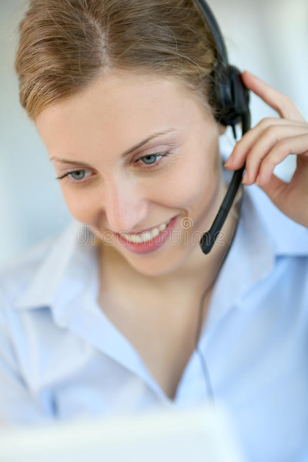 Young woman customer service employee stock photography