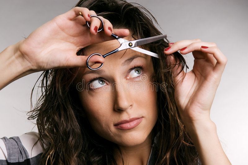 Download Young Woman Cutting Her Fringe Stock Image - Image: 6724981
