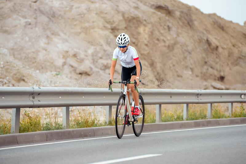 Young Woman Cyclist Riding Bike on the Mountain Road. Adventure, Healthy Lifestyle, Sport stock photos