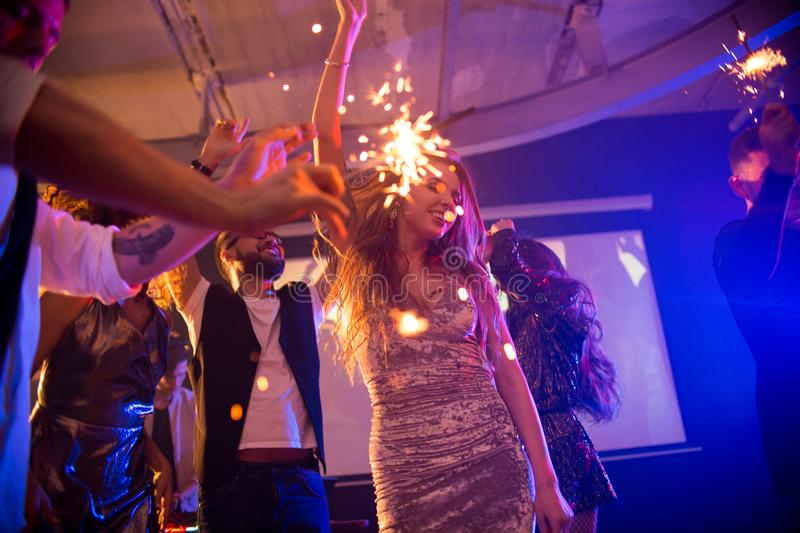 Young Woman Dancing at Awesome Party stock photos