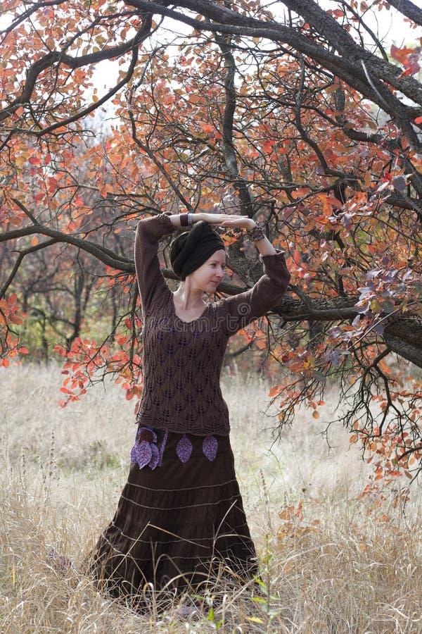 Young woman dancing magic dance. Young woman dancing ritual magic dance outdoors royalty free stock image