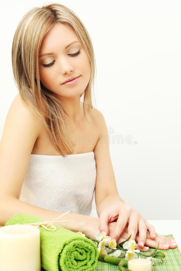 Young woman, day spa. Young woman, body care - day spa royalty free stock photos