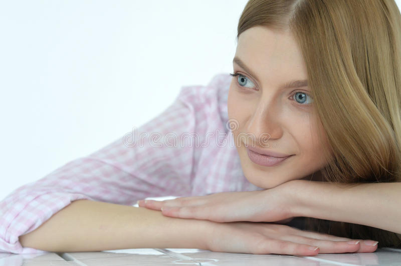 Young woman with deep blue eyes royalty free stock photos