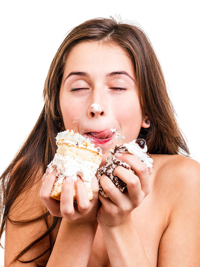 Young woman with a delicious cake royalty free stock photos
