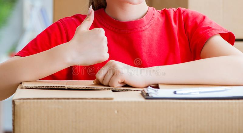 Young woman delivering boxes of personal effects stock image