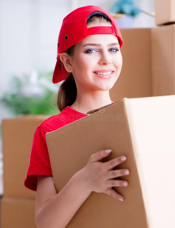 Young woman delivering boxes of personal effects. The young woman delivering boxes of personal effects stock photography