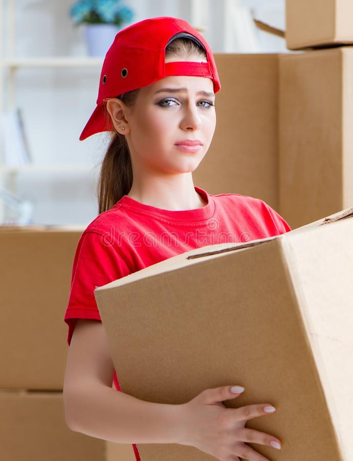 Young woman delivering boxes of personal effects royalty free stock photos