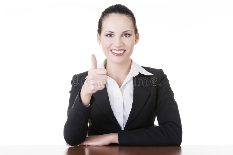 Download Young Woman At The Desk Gesturing OK Stock Photo - Image: 30223906