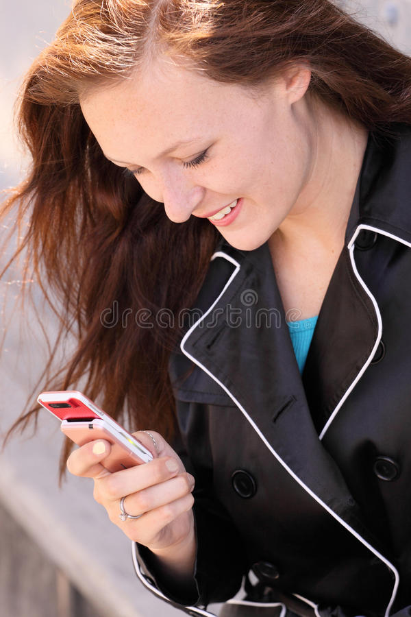 Young woman dialing number cell phone stock photos