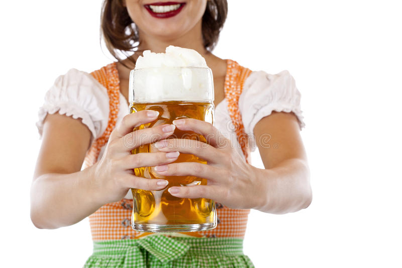 Young woman in dirndl holds Oktoberfest beer stein. Pretty young woman with dirndl holds Oktoberfest beer stein. Isolated on white background royalty free stock images