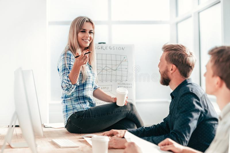 Young woman discussing with colleagues new strategy royalty free stock images