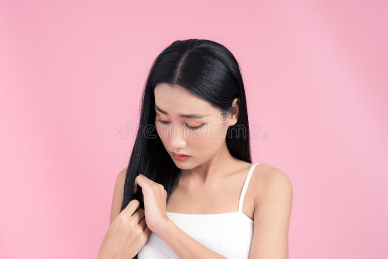 Young woman is dissatisfied with the state of their hair royalty free stock photography