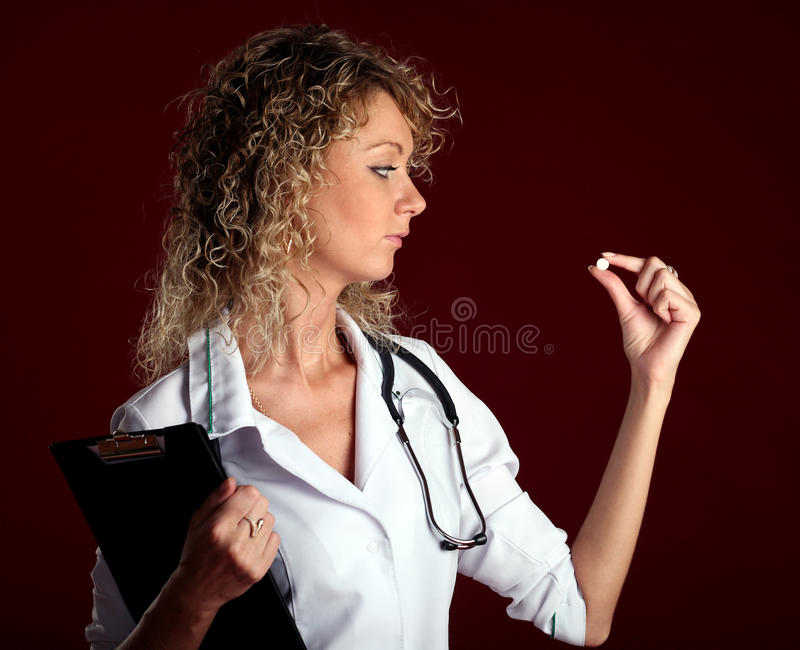 Young Woman Doctor With A Pill Stock Image