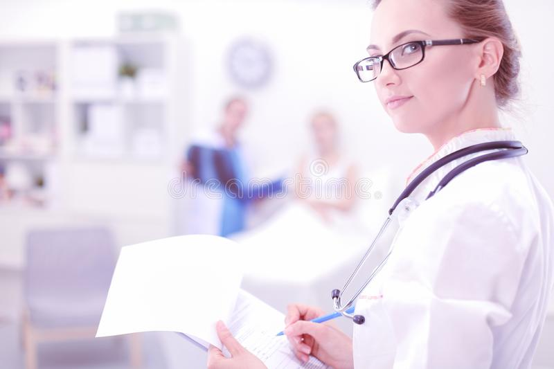 Young woman doctor standing at hospital with medical stethoscope stock images
