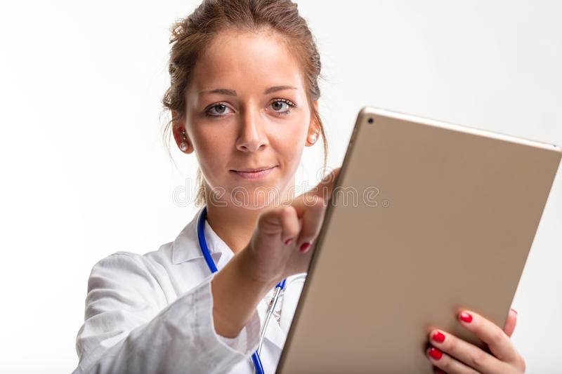 Young woman doctor using a tablet pc royalty free stock image