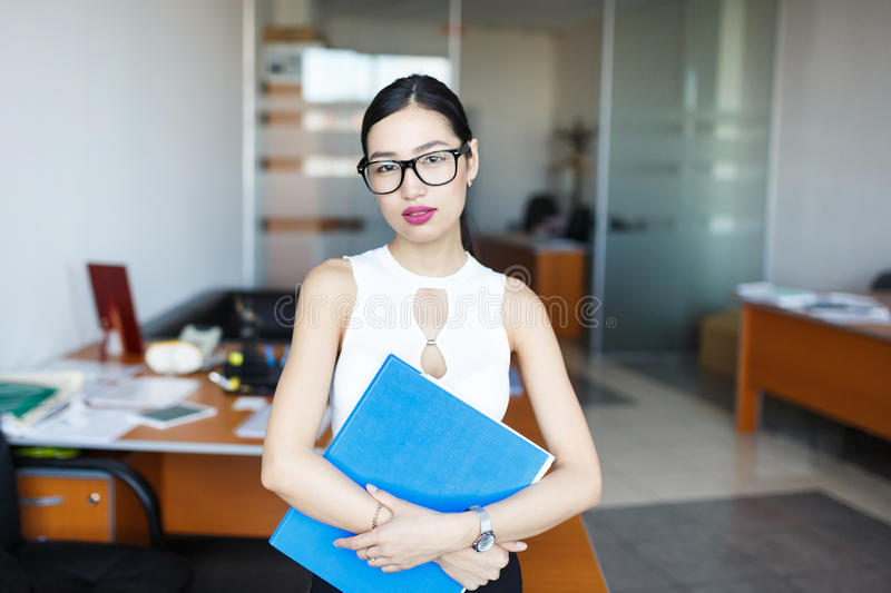 Young woman with document case stock images