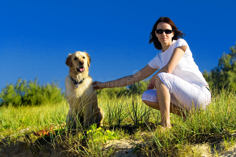 Download Young Woman And A Dog Sitting Stock Image - Image: 5980657