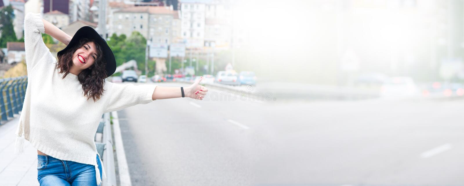 Young woman doing auto stop royalty free stock photos