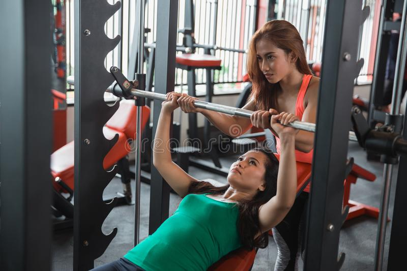 Young woman doing bench press stock photo