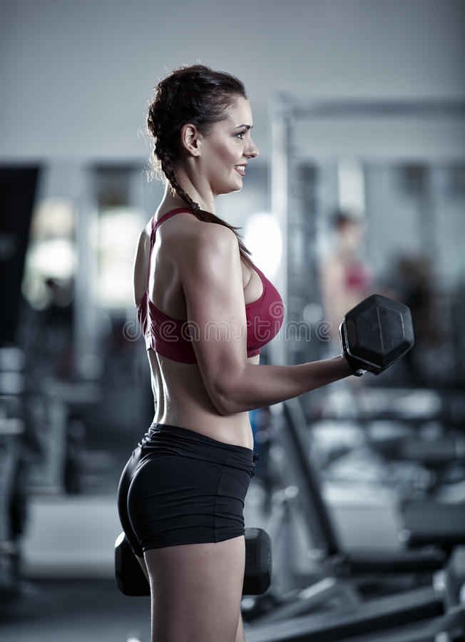 Young woman doing biceps workout royalty free stock photos