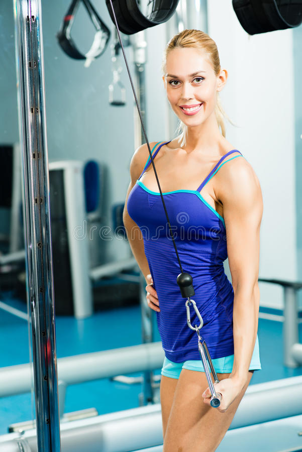 Download Young Woman Doing Body-building In The Gym Royalty Free Stock Photos - Image: 28287518