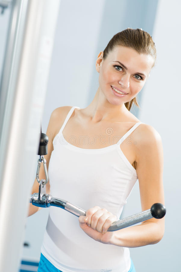 Download Young Woman Doing Body-building In The Gym Stock Photo - Image: 28291434